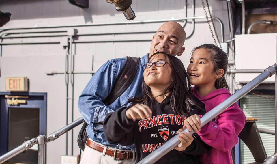 A family inspecting a piece of equipment in the Observatory at the Franklin Institute.