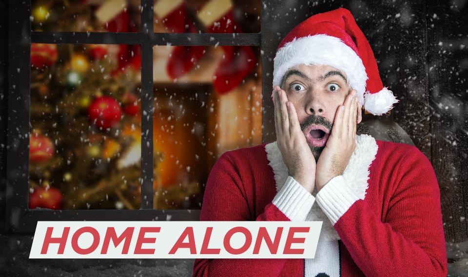 Photo of man wearing a Santa Christmas suit and looking surprised