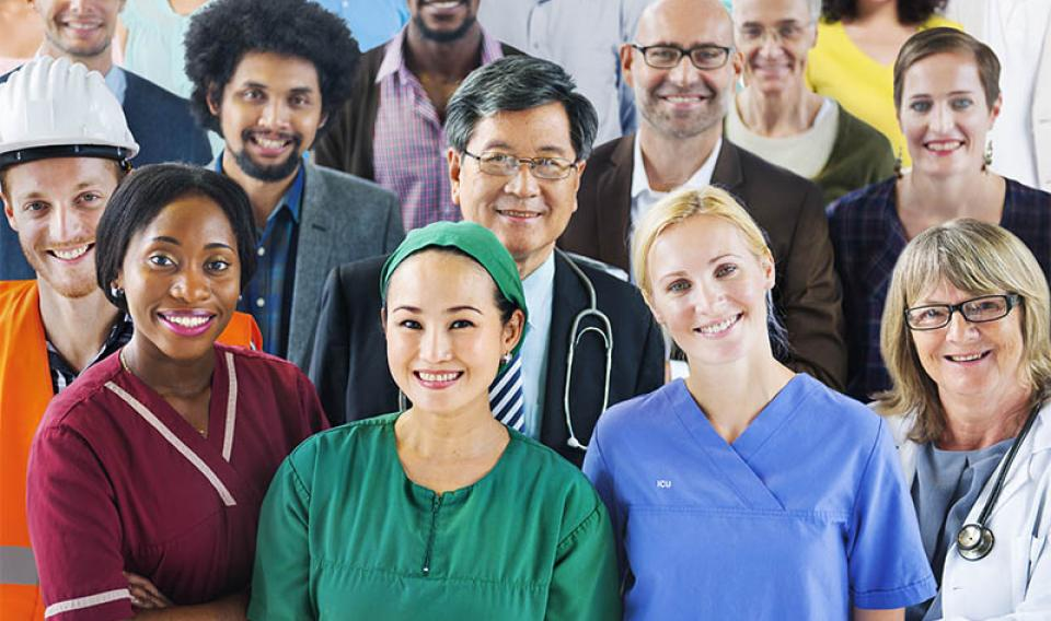 Photo of a diverse group of professionals in uniforms: doctors, nurses and other staff