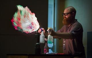 Image of multicolored flame coming from a bottle as part of combustion activity