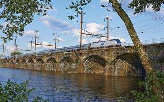 An Amtrack train crossing a bridge.