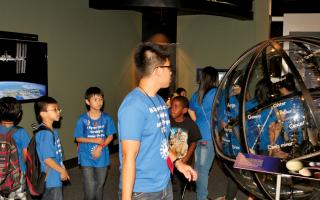 Children walking through Space Command while on a field trip to The Franklin Institute.