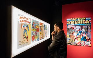 Man looking at comic book display in the Marvel Exhibit