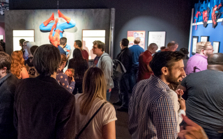 Photograph of a crowd viewing the Marvel: Universe of Super Heroes exhibit